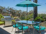 Patio set for 6 with 8 additional chairs and extra table.  Ocean views and propane BBQ