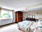 Spacious double bedrom with stylish furnishings