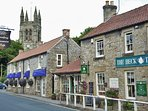 The quaint old market town of Helmsley is nearby