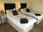 The rear bedroom can be set up as two full sized single beds upon request.
