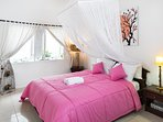 Another bedroom, also with big bed, mosquito net, aircon and ensuite