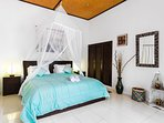 One of the bedrooms with big bed, aircon, mosquito net and ensuite