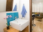 Turquoise and white colored guest bathroom (Half bathroom on the livingroom area)