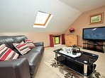 Spacious lounge with freeview tv and dvd player