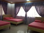 Bedroom no. 4 - airconditioned, with 3 queen size (60 inch) beds and a private toilet and bathroom