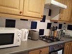 A modern kitchen with all of the appliances you will need.
