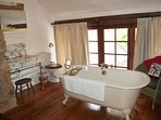 The Victorian Free Standing bath has views across the garden. A G & T whilst relaxing?