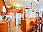 Fully Equipped Kitchen and Breakfast Bar has Lovely Woodwork