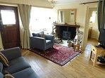 Comfy sitting room with log burner for those chillier nights.