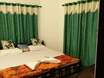 A/c twin deluxe room private attached bathroom and toilet accessories including hot water