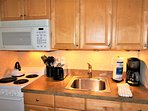 Microwave, Toaster and Coffeemaker!  Four burner stove and oven!