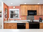 Hickory cabinets with quartz counter tops.
