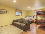 Downstairs bedroom sleeps up to 4 people with extra seating area