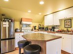 Kitchen has all you need to cook the family feast, plus extra seating for two