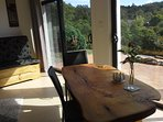 Handcrafted Macrocarpa timber dining table with view to the North West