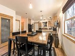 Additional seating is available at the kitchen island with bar stool seating.
