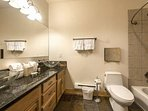 The third bathroom (3) features an extra long granite vanity with his and hers glass vessel sinks, lots of storage...