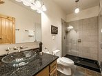 The second bathroom (2) features an oversized walk in glass shower, large granite vanity, floating glass vessel sink...
