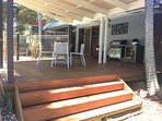 Rear deck area overlooks pool and fully fenced yard area