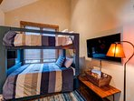 This bedroom also features a TV.