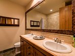 The private bathroom to Master Bedroom #1 has a double vanity and a tub/shower combo.