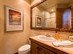 This bathroom is located on the first floor and has a walk-in shower.