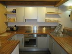 Modern kitchen with integrated dishwasher, washing machine and oven