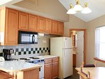 The kitchen has enough seating for six and is ideal for socializing while cooking