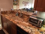 Granite countertop raised bar with 4 chairs