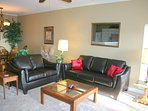 Plenty of seating to enjoy the gas fireplace or watch the flat screen television.