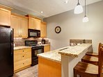 Fully-equipped gourmet kitchen with granite countertops