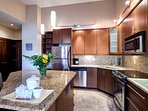 The kitchen features granite countertop and stainless steel appliances