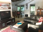 Spacious main living room room provides comfortable lounges, flat screen TV