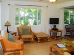 The home is stylishly decorated with quality furnishings.Living room with seating and TV.