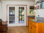 Double doors lead out to lanai. Kitchen is just to the right of the frame.
