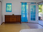 Step out onto the queen bedroom's private lanai