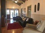 Second living area provides comfortable lounges, Flatscreen TV
