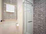The ensuite bathroom has a walk in shower, toilet and wash basin