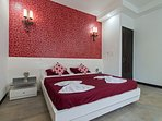 Stylish bedroom with all your comforts thought about.