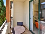 Private balcony with bistro table and chairs