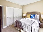 Second bedroom with queen bed, tv and spacious closet