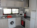 Equipped Kitchen with washing machine, cooker/hob, Fridge/Freezer, Microwave and more.