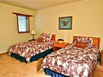 Spacious 3rd bedroom with twin beds.