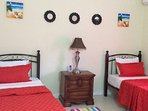 Air conditioned 3rd bedroom with twin beds.