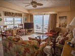 Serene ocean views from the comfort of the spacious living room with seating for 8 and flat screen TV