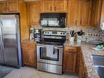 Open, fully equipped kitchen with stainless steel appliances