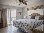Ocean views from the master bedroom with king bed and flat screen TV