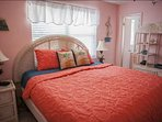 Guest bedroom with queen bed, private bathroom and flat screen TV