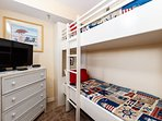 The kids love this cute bunk room, with their own television and