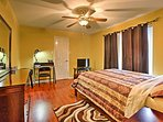 Watch a movie on the flat screen cable TV before falling asleep in this plush queen-sized bed.